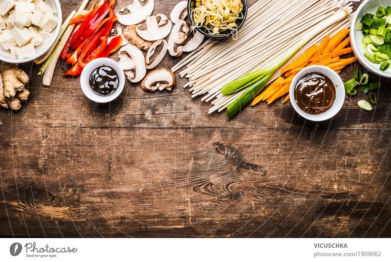 Asian cooking with noodles, tofu and vegetables Food Vegetable Herbs and spices Cooking oil Nutrition Lunch Dinner Banquet Asian Food Crockery Bowl Style Design