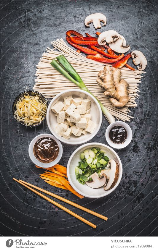 Asian ingredients and chopsticks with tofu and noodles Food Vegetable Herbs and spices Nutrition Lunch Dinner Buffet Brunch Organic produce Vegetarian diet Diet