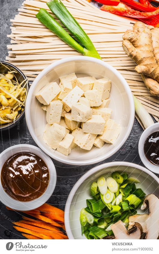 Asian cooking ingredients with tofu and noodles Food Vegetable Herbs and spices Lunch Banquet Organic produce Vegetarian diet Diet Crockery Bowl Style Design