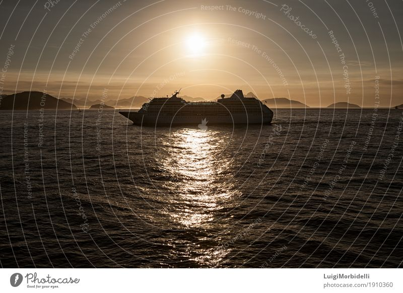 Cruise ship at sunset Relaxation Vacation & Travel Tourism Sun Ocean Mountain Nature Water Sky Clouds Horizon Summer Passenger ship Cruise liner Bright Gold