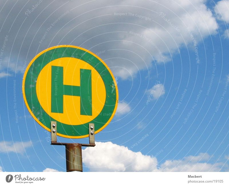 Sky Green Blue Clouds Yellow Letters (alphabet) Things Electricity pylon Fastening H