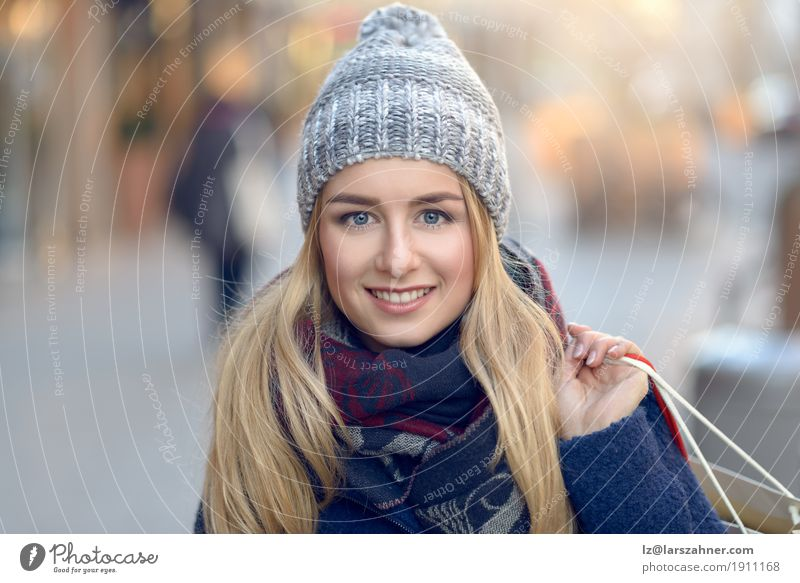 Gorgeous young woman out shopping Shopping Happy Beautiful Face Winter Woman Adults 1 Human being 18 - 30 years Youth (Young adults) Pedestrian Street Fashion