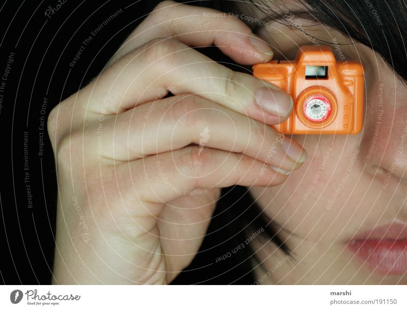 Woman Human being Hand Joy Feminine Head Orange Photography Adults Small Fingers Leisure and hobbies Camera Toys To hold on Passion