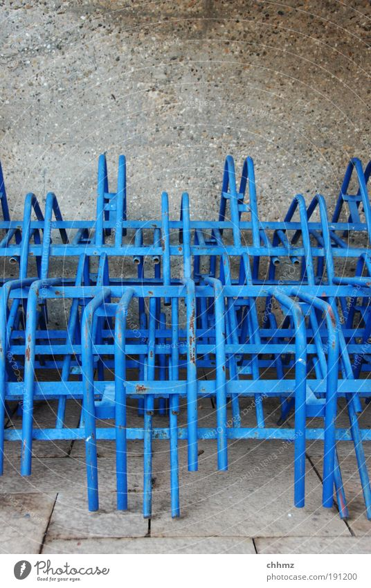 Stacked stands Calm Arrangement Bicycle rack Winter Iron-pipe Blue Pillar Concrete wall Colour photo Exterior shot Close-up Copy Space top Day Long shot