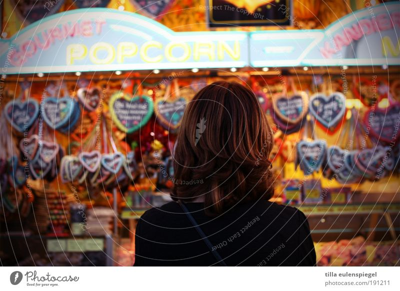 Woman Human being Youth (Young adults) Think Adults Feasts & Celebrations Wait Shopping Desire Observe Discover Brunette Candy Fairs & Carnivals Anonymous Baked goods
