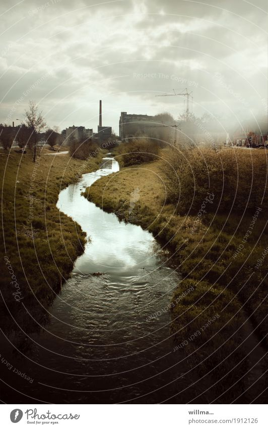 The river of time Clouds Bad weather Bushes River bank Brook Chemnitz Industrial plant Factory Manmade structures Chimney Dark Flow Crane