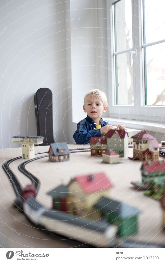 Human being Child House (Residential Structure) Life Boy (child) Transport Infancy Railroad Logistics Village Watchfulness Railroad tracks Toddler