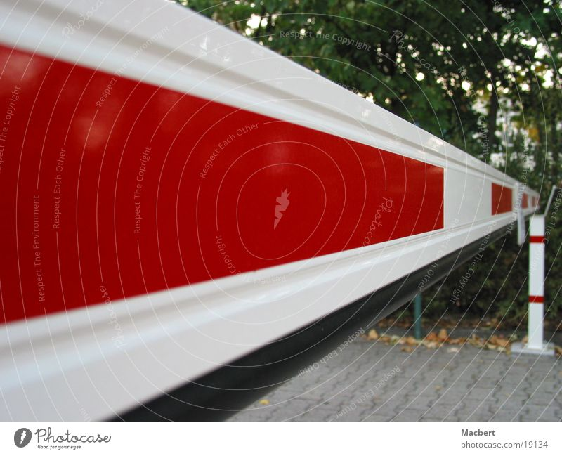 Barrier closed Control barrier Red White Bushes Rectangle Long Electrical equipment Technology Street Paving stone