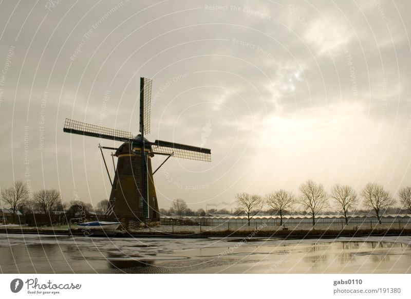 windmill Environment Nature Landscape Winter Climate Climate change Field River bank Work and employment Old Cold Brown Gray Windmill Windmill vane Sky Channel