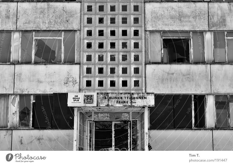 over Germany Europe Capital city Deserted High-rise Industrial plant Factory Ruin Facade Window Door Sadness Lose Black & white photo Exterior shot Day