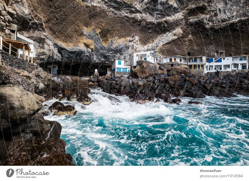 Rocks, water, houses Vacation & Travel Tourism Adventure Far-off places Beach Ocean Waves Coast Bay Fishing village Building Hut Romance Dangerous Threat Risk