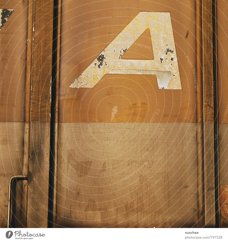 Old Brown Metal Signs and labeling Railroad Characters Digits and numbers Letters (alphabet) Transience Steel Rust Door handle Container Track Logo