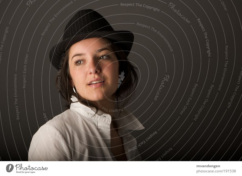 Manon 2010 Feminine Young woman Youth (Young adults) Human being Shirt Hat Black-haired Expectation Colour photo Studio shot Artificial light Shadow