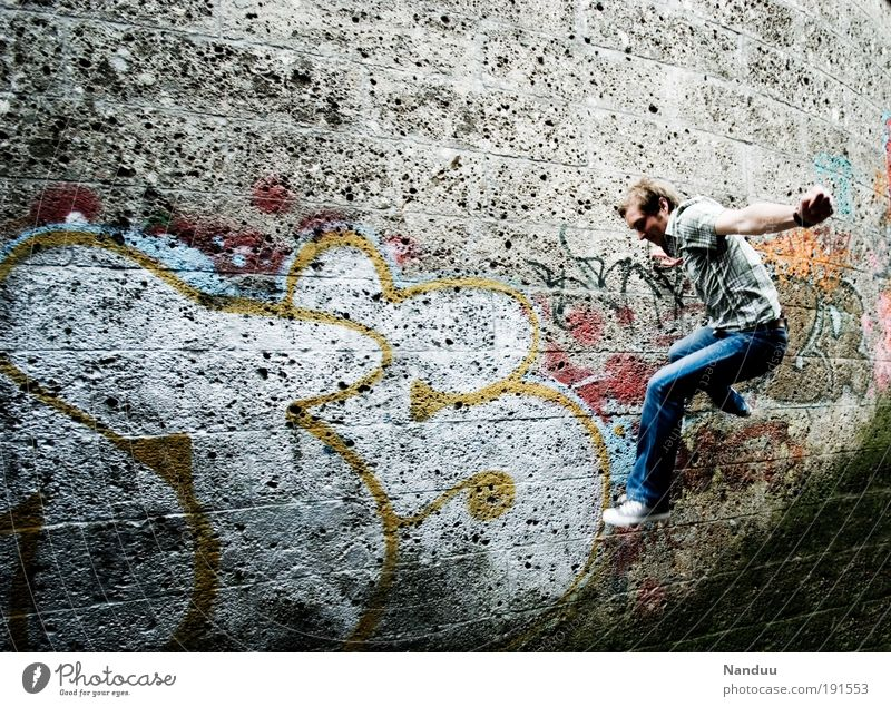 hop Human being Masculine 1 18 - 30 years Youth (Young adults) Adults Jump Wall (building) Wall (barrier) Graffiti Gray Town Colour photo Subdued colour