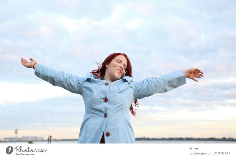 Enjoy. Feminine Woman Adults 1 Human being Sky Clouds Horizon Coast River bank Coat Red-haired Long-haired Relaxation To enjoy Dream Free Beautiful Emotions