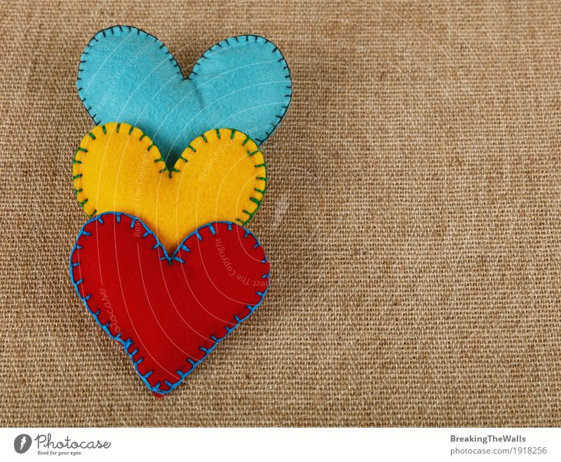 Three stitched hearts, yellow, red and blue on canvas Leisure and hobbies Handicraft Handcrafts Valentine's Day Wedding Family & Relations Art Cloth Heart Love