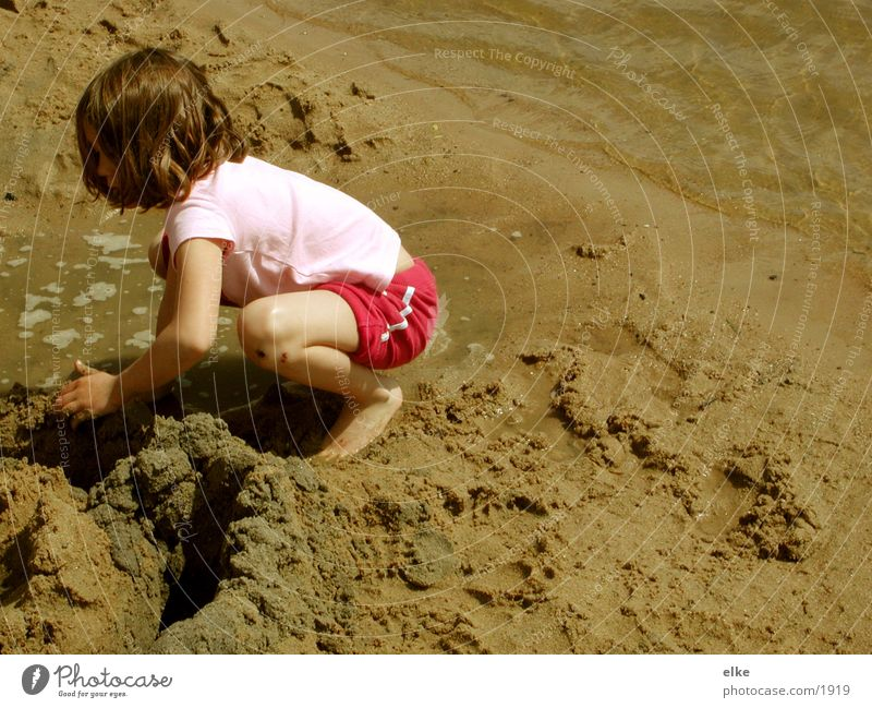 Human being Child Water Lake Sand Sandcastle