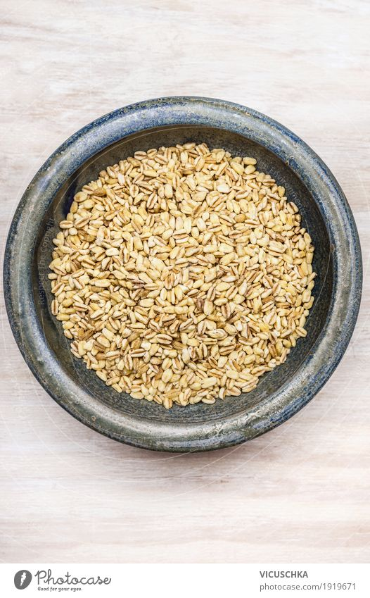 Graupe in the bowl on white background Food Grain Nutrition Organic produce Vegetarian diet Diet Style Design Healthy Healthy Eating pearl grain of pearl barley
