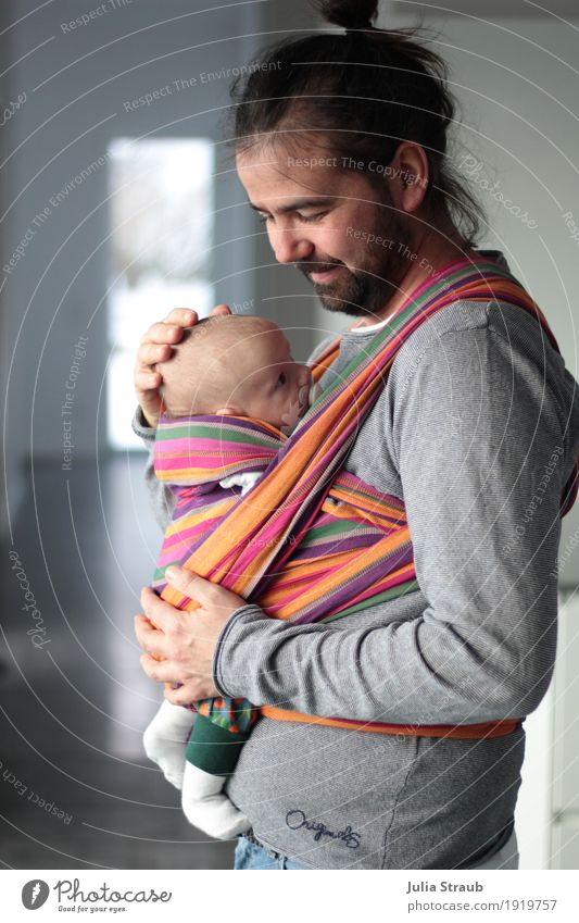 The modern man Masculine Baby Man Adults Father Infancy 2 Human being 30 - 45 years Sling Black-haired Long-haired Beard Chignon Happiness Together Hip & trendy
