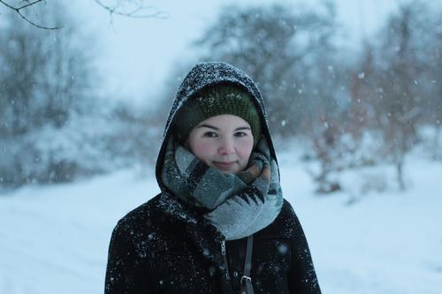 snow Feminine Woman Adults 1 Human being 30 - 45 years Winter Ice Frost Snow Snowfall Forest Coat Scarf Cap Looking Cold Gray Green Relaxation Exterior shot Day