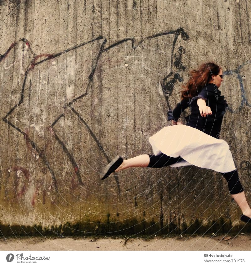 """200 """"The story can go on."""" Human being Feminine Young woman Youth (Young adults) 1 18 - 30 years Adults Wall (barrier) Wall (building) Skirt Leggings"""