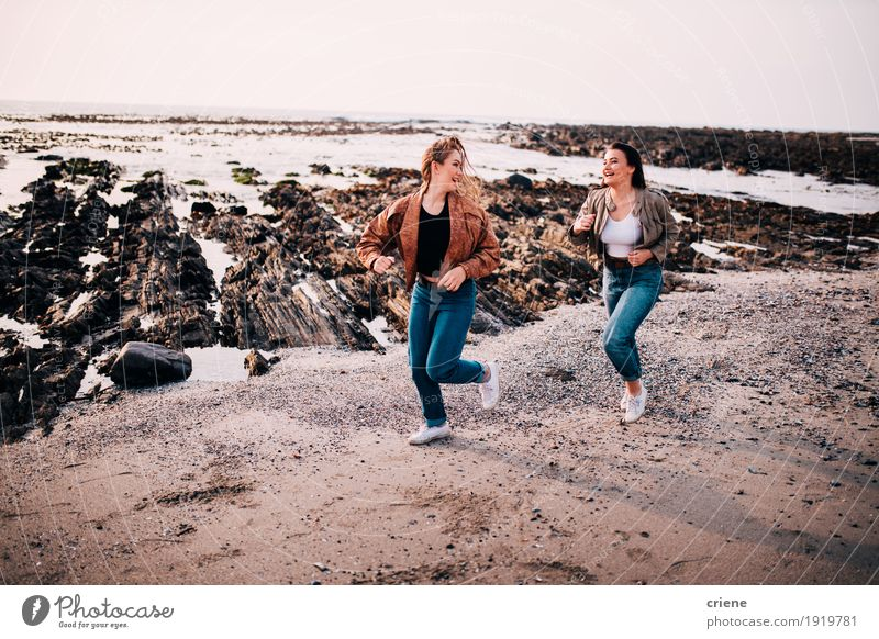 Teenager girls having fun running on the beach Human being Youth (Young adults) Young woman Ocean Relaxation Joy Beach 18 - 30 years Adults Lifestyle Feminine Laughter Happy Freedom Sand Friendship