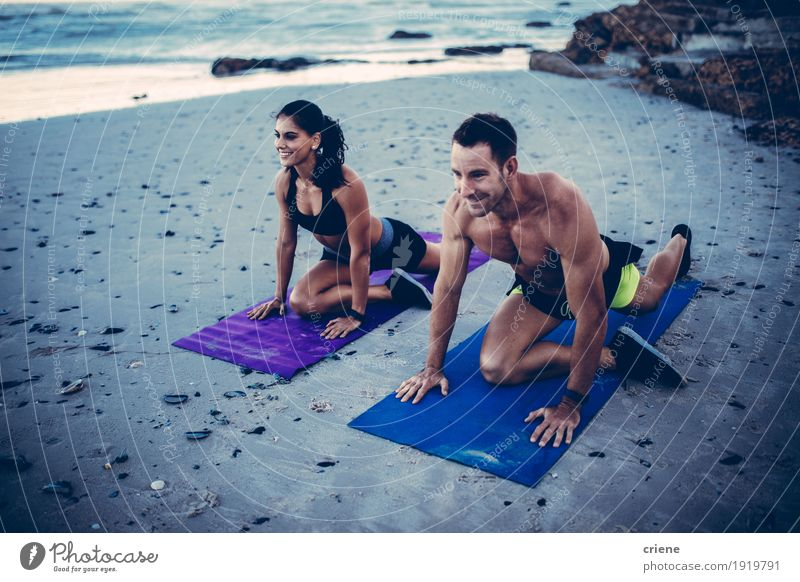 Caucasian fit young adult couple doing stretching exercises Lifestyle Joy Happy Athletic Fitness Beach Ocean Human being Young woman Youth (Young adults)