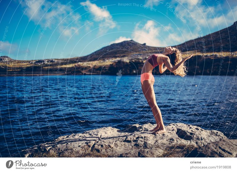 Young beautiful women practising yoga at a lake in nature Human being Woman Nature Youth (Young adults) Summer Young woman Ocean Joy 18 - 30 years Adults Life
