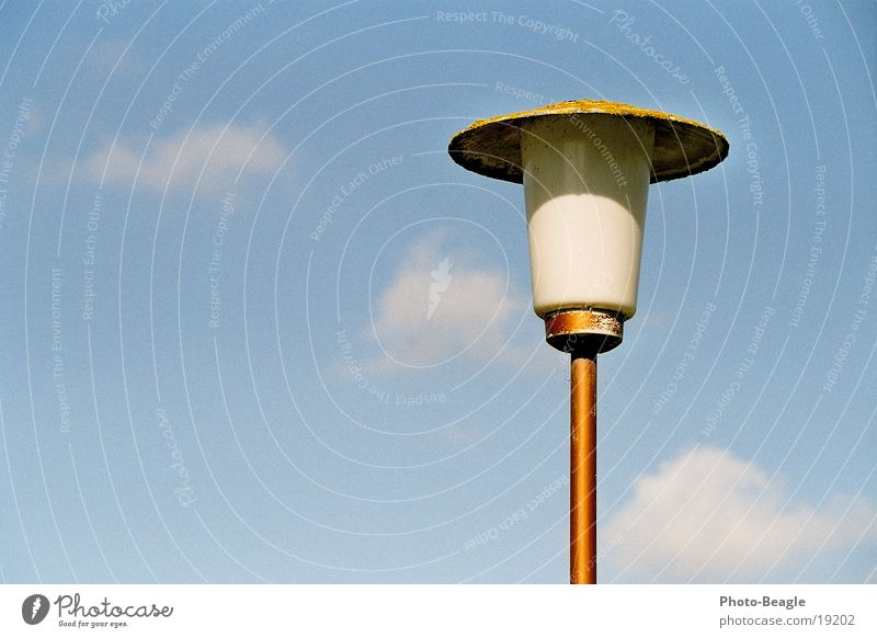 Think-Mag Lamp Lantern Street lighting Light Sixties Clouds Living or residing Sky Blue