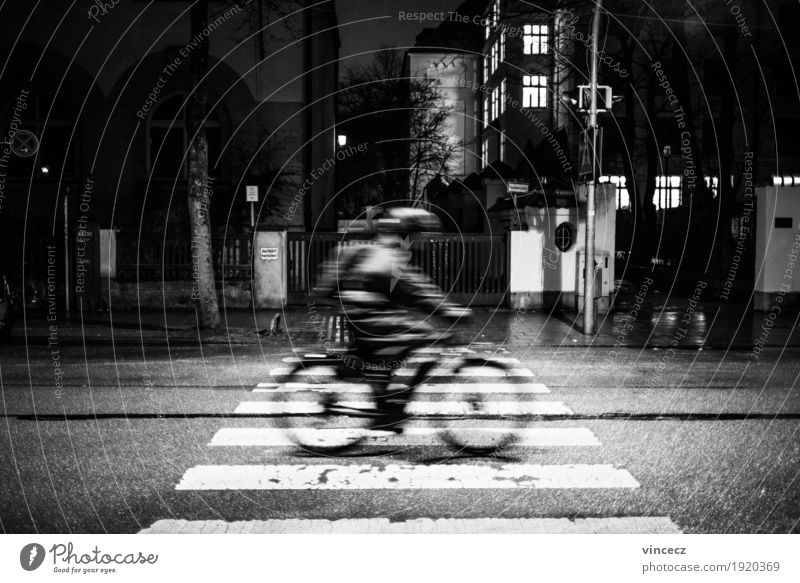 night ride Cycling Bicycle Work and employment Office work Human being Town Transport Means of transport Road traffic Street Road sign Zebra crossing Jacket