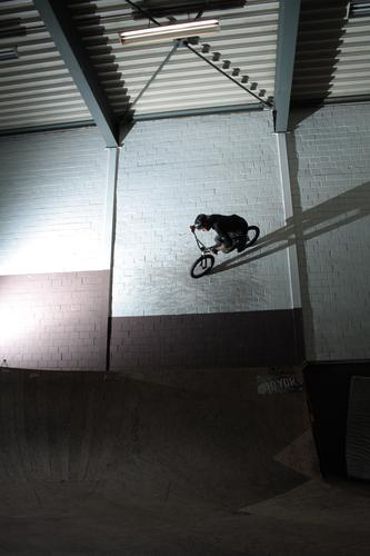 ride the wall. Joy Leisure and hobbies BMX bike Sports Sportsperson Cycling Sporting Complex skate hall Masculine Young man Youth (Young adults) Life 1