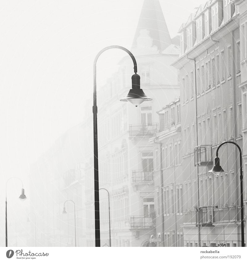 Row of houses with street lamps Flat (apartment) Dresden Town House (Residential Structure) Esthetic Threat Dirty Dark Elegant Cold Gray Emotions Trust Safety