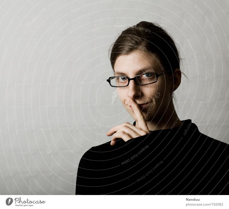kept one's mouth shut Human being Feminine 1 18 - 30 years Youth (Young adults) Adults Nerdy Cliche Impish Person wearing glasses Calm Gesture Gray Smiling