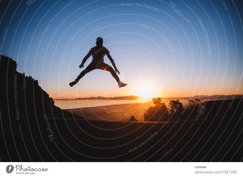 Silhouette of cheerful young man jumping high in sunset Nature Youth (Young adults) Man Summer Beautiful Sun Young man Landscape Joy Adults Lifestyle Freedom Tourism Jump Copy Space Trip