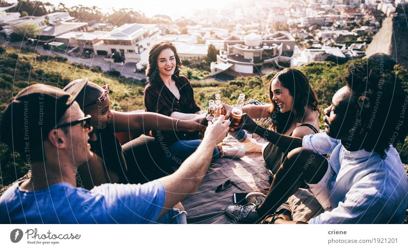 Mutli Ethnical group toasting and drinking beer on a rock Human being Youth (Young adults) Summer Young woman Young man Joy Mountain Lifestyle Feasts & Celebrations Group Together Friendship Birthday Smiling Beverage Drinking