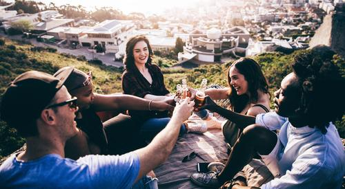 Mutli Ethnical group toasting and drinking beer on a rock Human being Youth (Young adults) Summer Young woman Young man Joy Mountain Lifestyle
