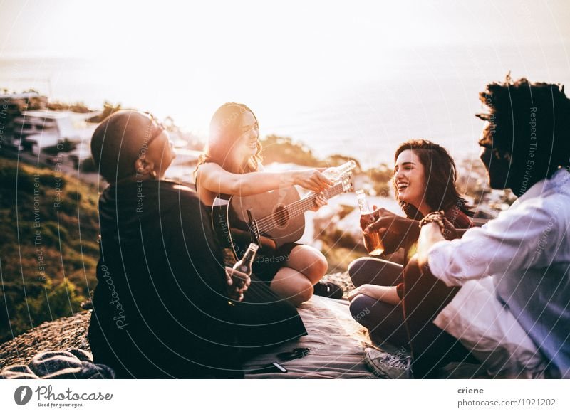 Group of friends enjoying drinks and playing guitar Joy Adults To talk Lifestyle Laughter Group Together Friendship Music Happiness To enjoy Smiling Beverage Beer Listening Bottle