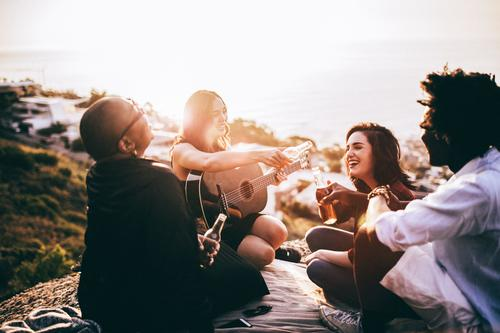 Group of friends enjoying drinks and playing guitar Joy Adults To talk Lifestyle Laughter Together Friendship Music Happiness To enjoy Smiling Beverage Beer