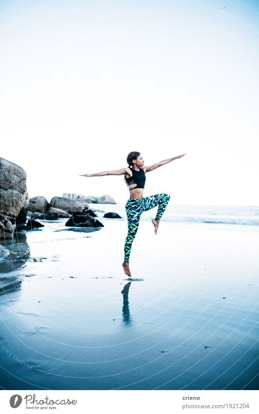 Young african women doing yoga pose on beach Woman Nature Youth (Young adults) Blue Young woman Ocean Beach Adults Lifestyle Sports Feminine Sand Rock Bright