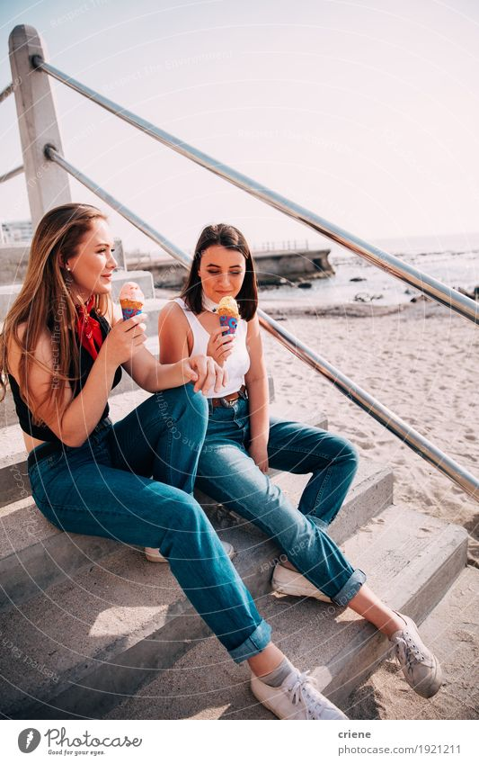 Caucasian Teenager girls enjoying ice cream on the beac Human being Vacation & Travel Youth (Young adults) Summer Young woman Ocean Joy Beach Eating Lifestyle Together Friendship Leisure and hobbies Sit To enjoy Smiling