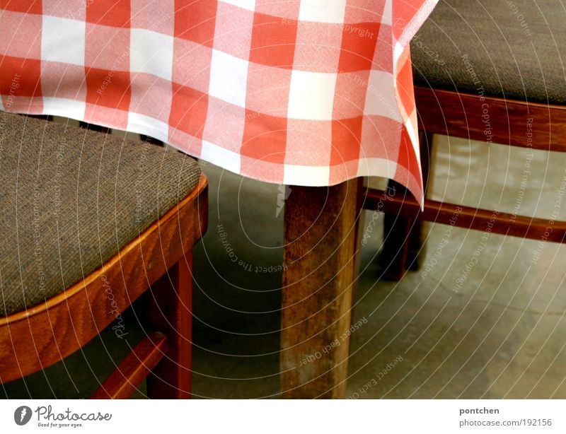 Two chairs stand at a table with red and white tablecloth. Visit to a café or restaurant. Furniture Relaxation Vacation & Travel Tourism Trip Living or residing