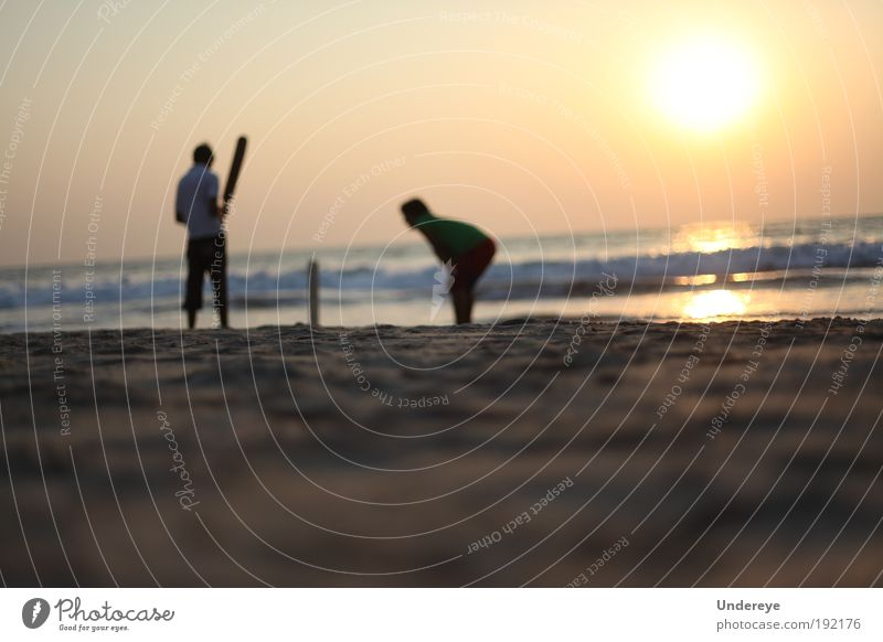 Sunset Cricket Sports Sports team Human being Youth (Young adults) 2 Nature Sand Air Water Sky Summer Warmth Exotic Coast Beach Playing Yellow Gold Colour