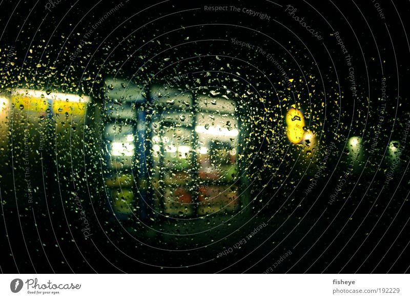 terrible weather Drops of water Bad weather Rain Door Dark Wet Gloomy Blue Yellow Boredom Loneliness Distress Frustration Disappointment Cold Colour photo