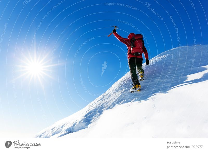 Climber at the top of a snowy peak in the Alps. Human being Nature Vacation & Travel Man Colour Landscape Red Loneliness Winter Mountain Adults Snow Sports