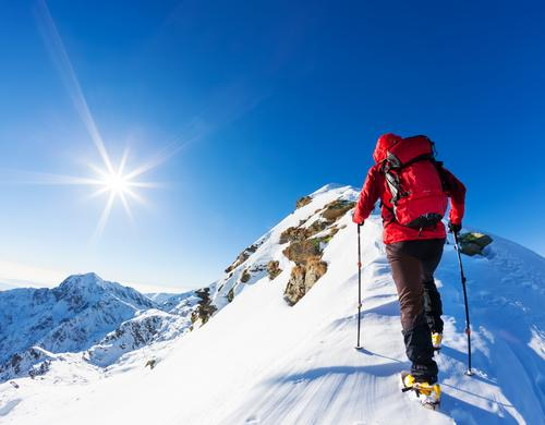 Climber at the top of a snowy peak in the Alps. Human being Nature Vacation & Travel Man Blue Colour Landscape Red Loneliness Winter Mountain Adults Snow Sports