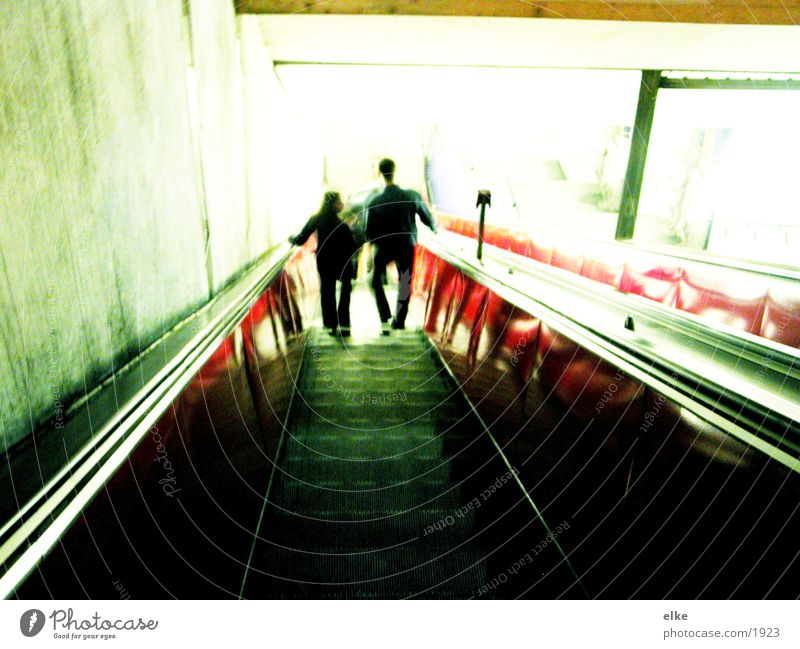 The light calls Escalator Light Red Green Neon light Transport Human being Contrast