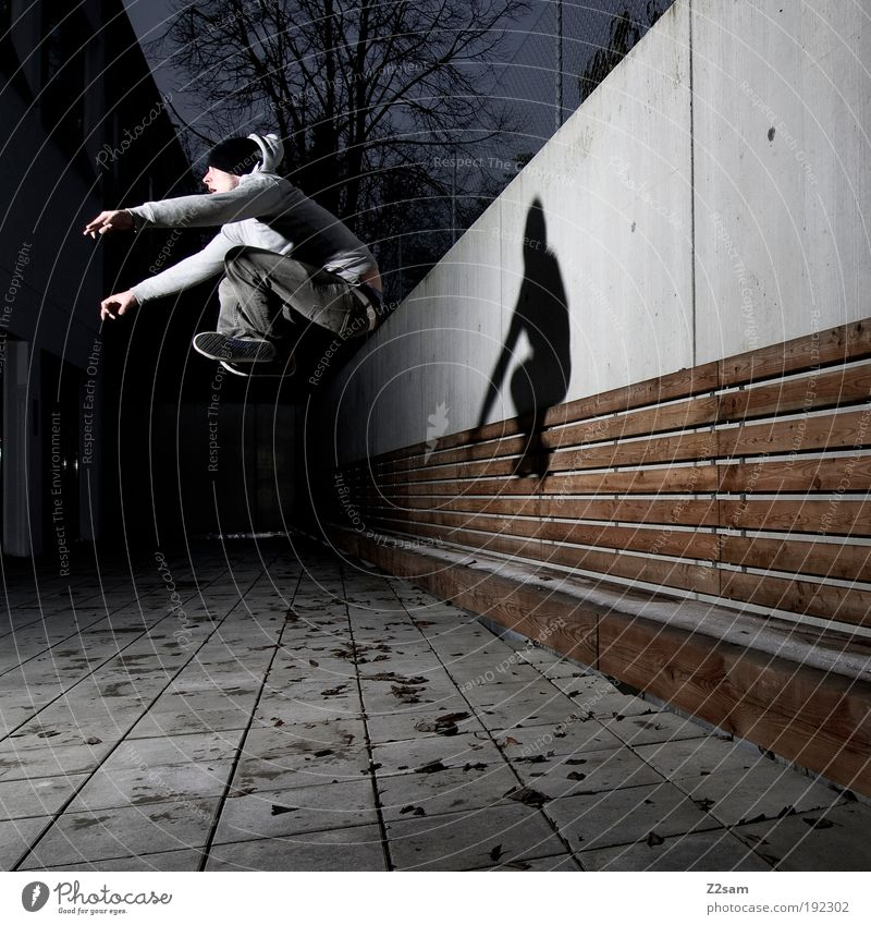 Human being Youth (Young adults) Adults Dark Wall (building) Architecture Movement Jump Wall (barrier) Building Style Elegant Flying Masculine Design