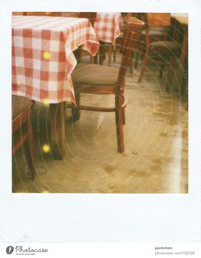 Polaroid shows tables and chairs in a restaurant. guest room. Red and white checked tablecloth. Vacation & Travel Tourism Trip Arrange Interior design