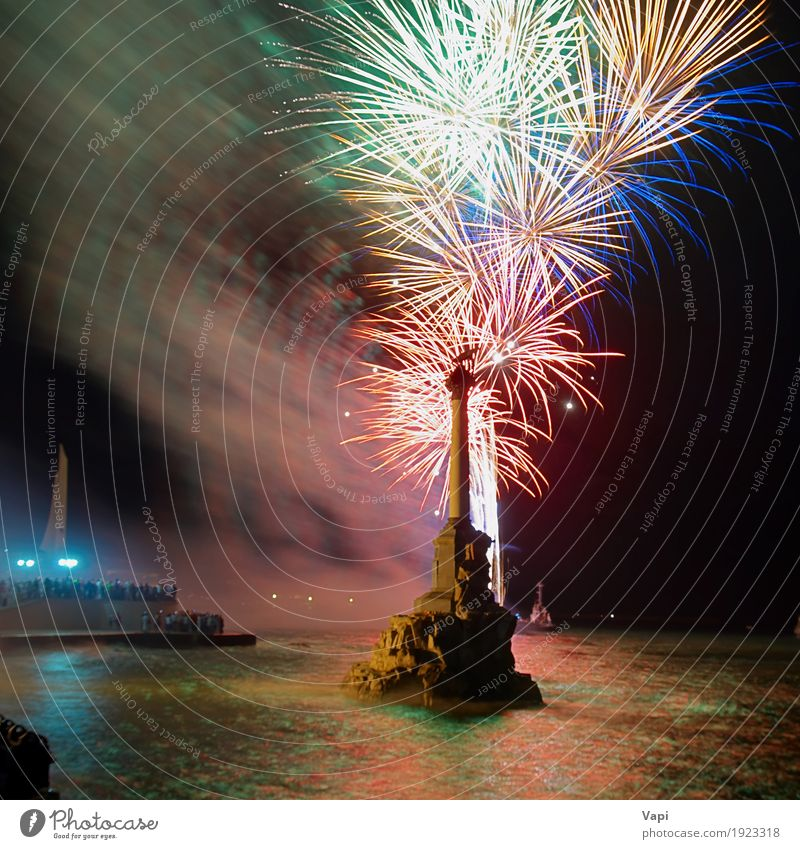 Colorful fireworks Joy Night life Entertainment Party Event Feasts & Celebrations Christmas & Advent New Year's Eve Shows Water Sky Night sky River bank Lake