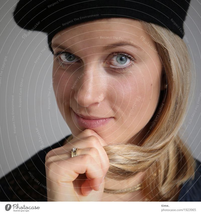 . Feminine Woman Adults 1 Human being Jacket Ring Cap Blonde Long-haired Observe To hold on Smiling Looking Study Wait Friendliness Astute Beautiful